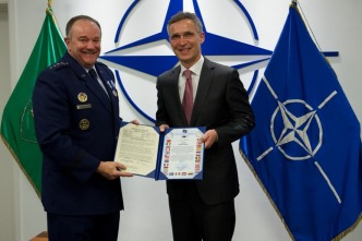 Outgoing SACEUR General Philip Breedlove is presented with NATO Meritorious Service Medal by NATO Secretary General Jens Stoltenberg