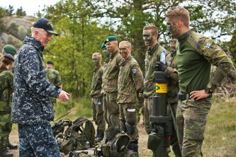 Vice Adm. James G. Foggo, III, speaks with Finnish Coastal Rangers in BALTOPS Excercise. UTO_SWEDEN JUNE 12, 2016