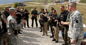 The Multinational Battle Group-East Military Provost Marshals office gives brief to NATO Forces Kosovo in Camp Bondsteel, Kosovo, July 26, 2016 EUCOM